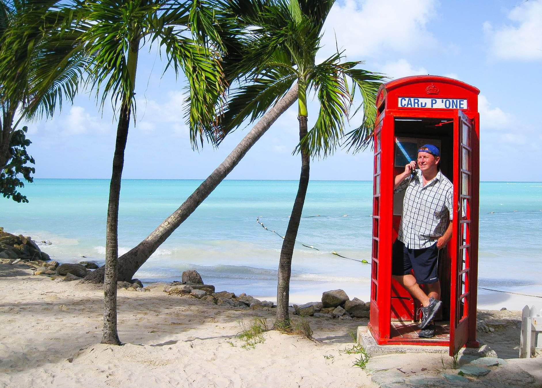 St.John's, Antigua and Barbuda. Dickenson Bay and the famous red telephone box